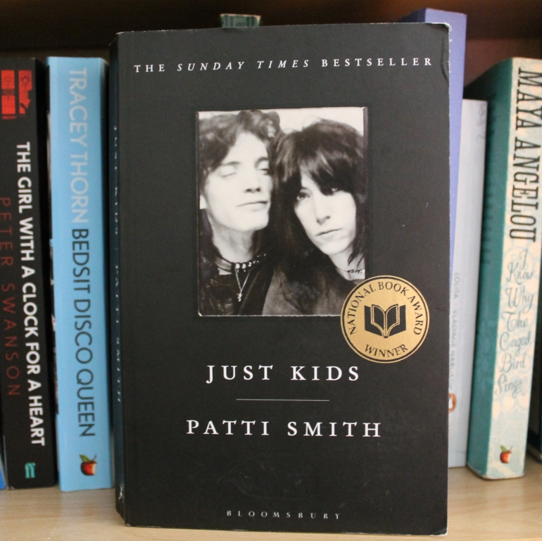 Rosie's tattered copy of the cover of 'Just Kids' - it features of black and white image of Smith and Roert Mapplethorpe