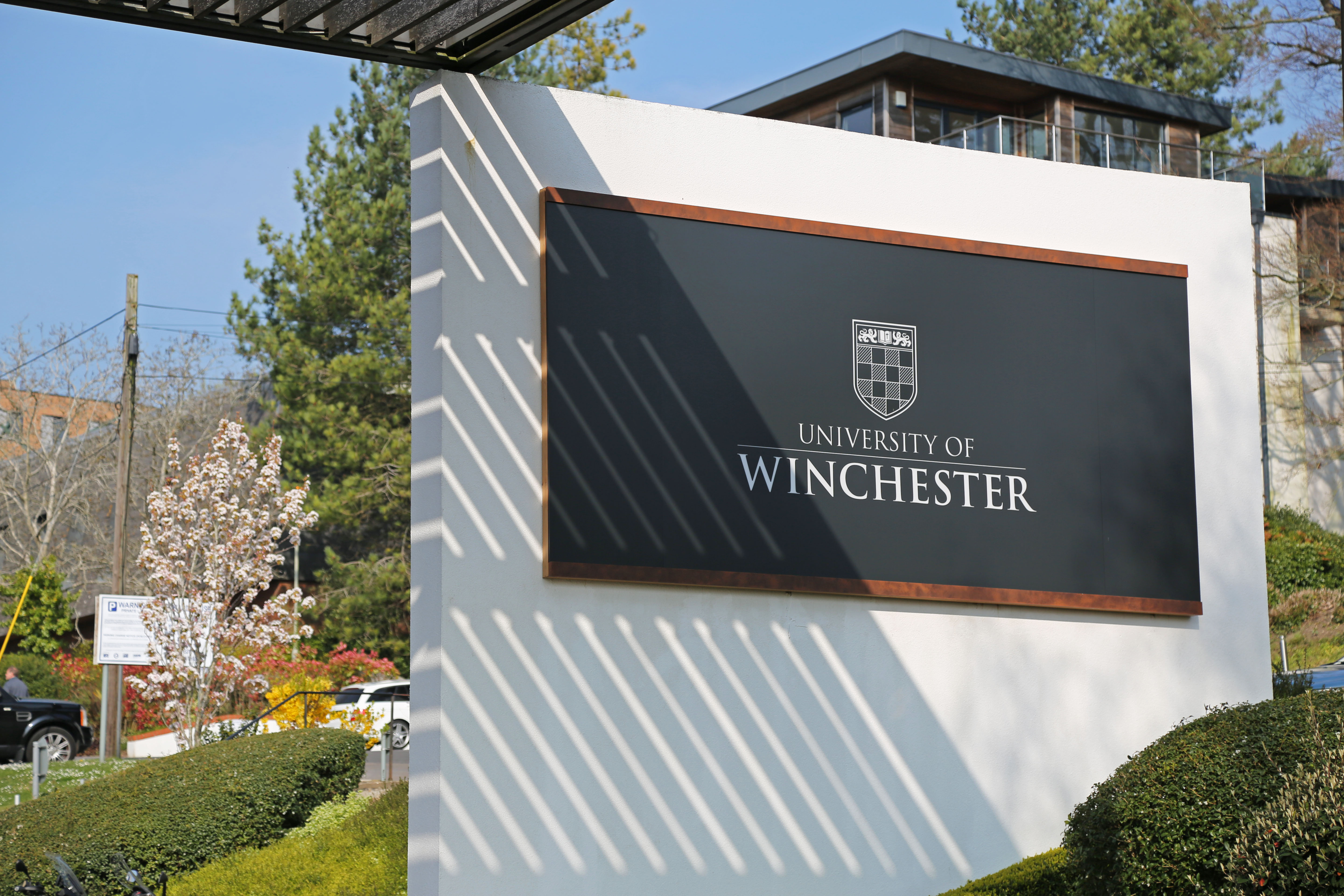 Picture of the main campus sign with 'University of Winchester' and crest