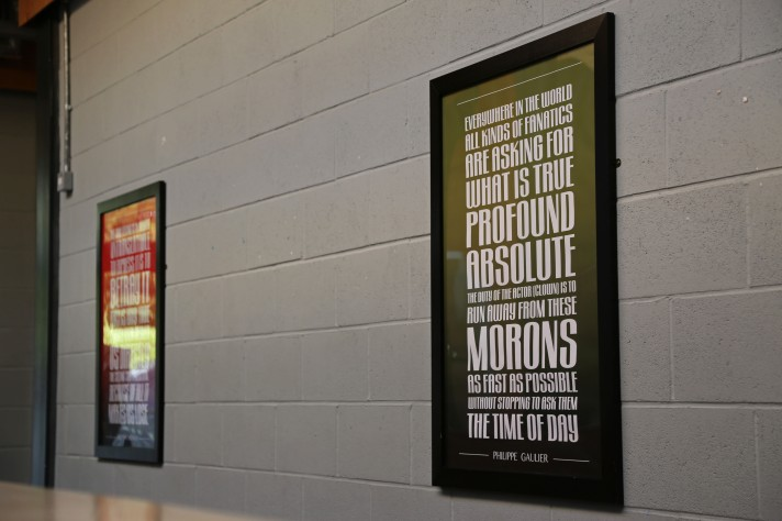 Two framed photos of quotes on the walls on the Paul Chamberlain Buildling.