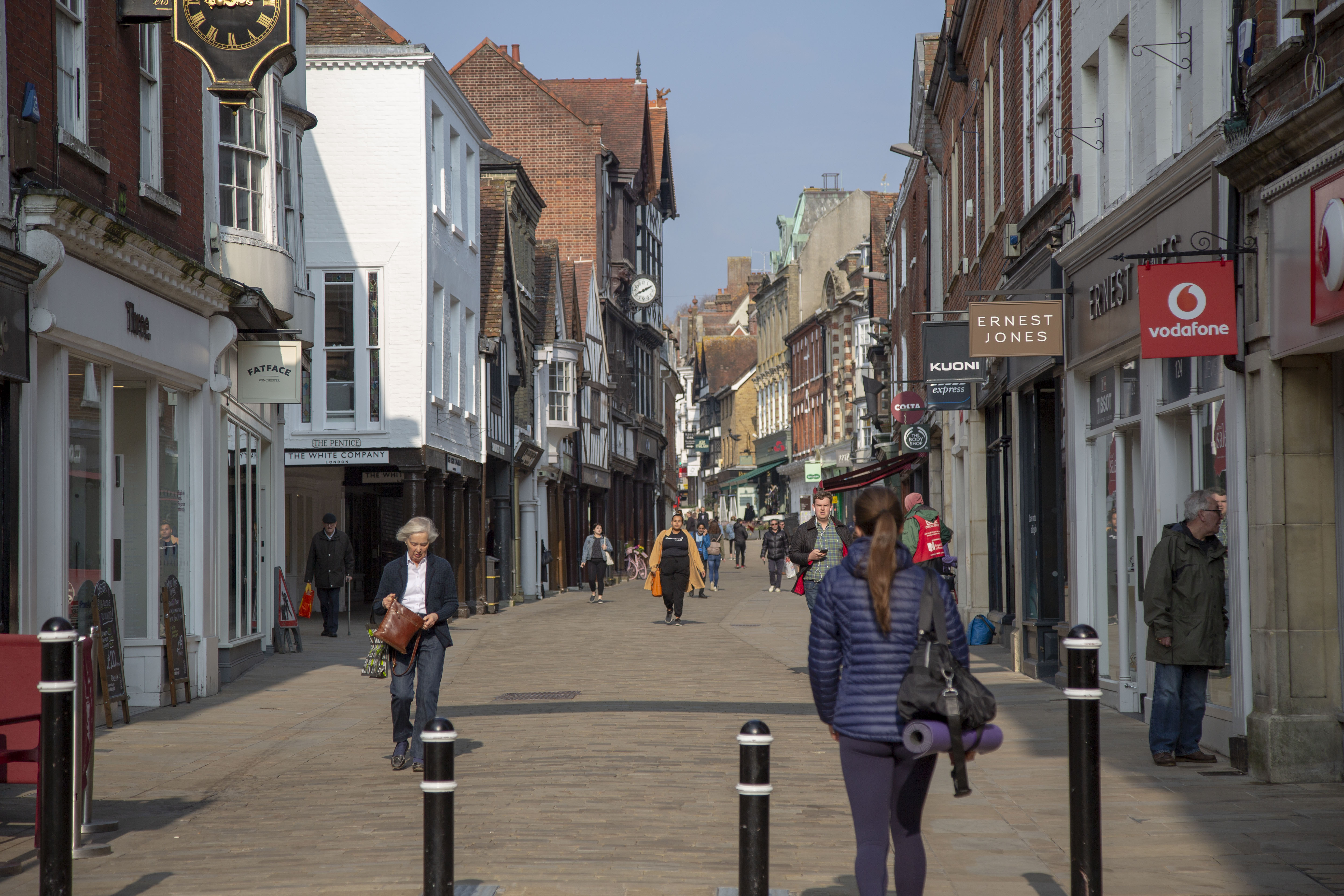 A picture of Winchester High Street and shoppers