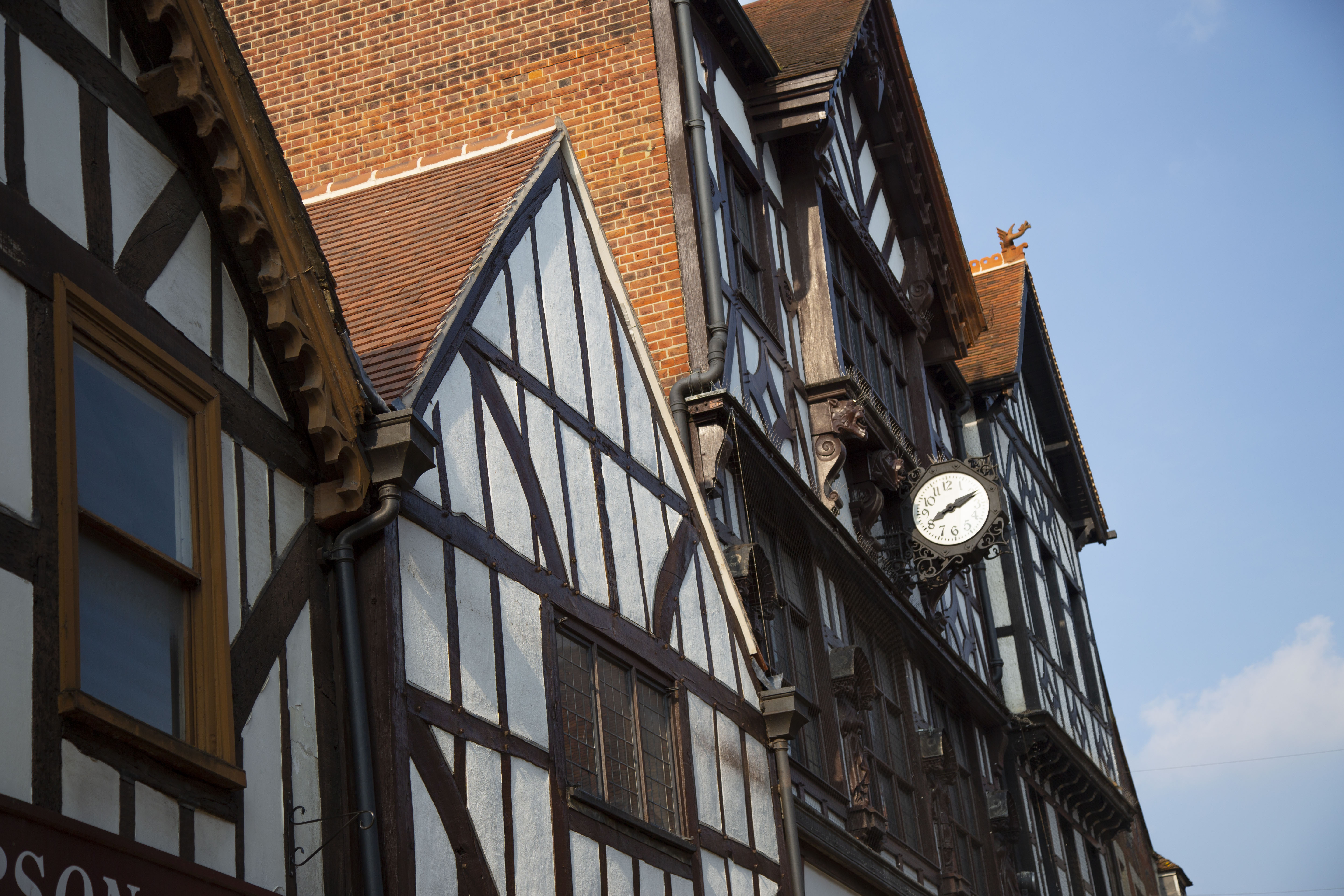 The top stories of some of Winchester's shops, decorated in a white and black Tudor visage