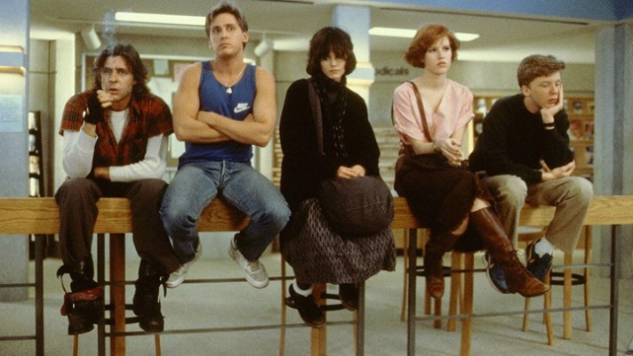 Five characters from The Breakfast Club sitting on a desk