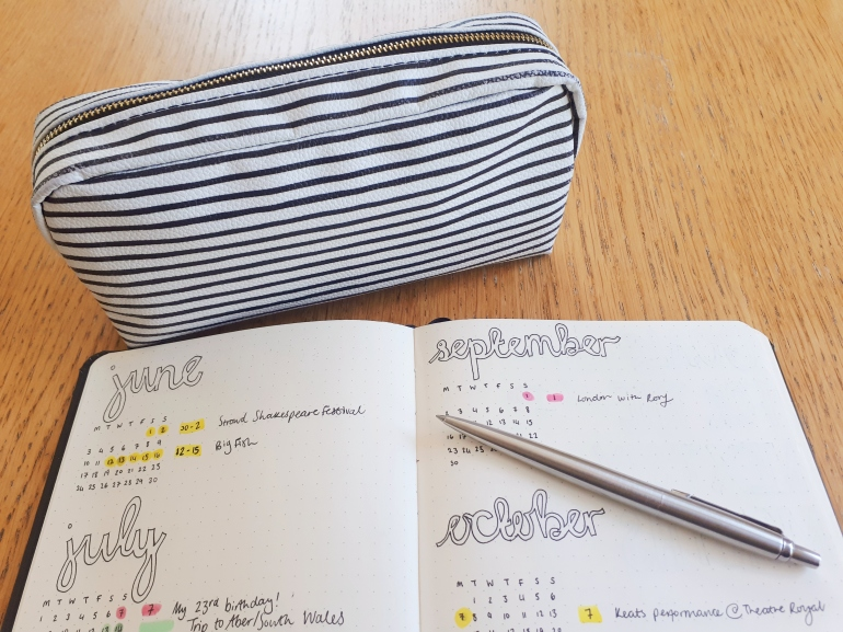 Nautical striped pencil case with a shot of Rosie's bullet journal, and silver Parker pPen