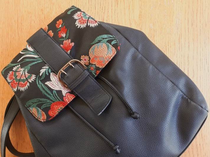 Picture of a black backpack from Primark with a floral detail