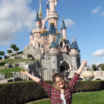 Rosie stood infront of Sleeping Beauty's Castle in Disneyland Paris
