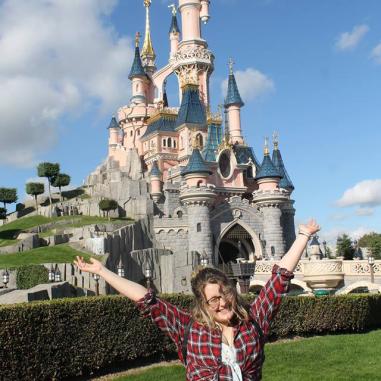 Rosie stood infront of Sleeping Beauty's Castle in Disneyland Paris