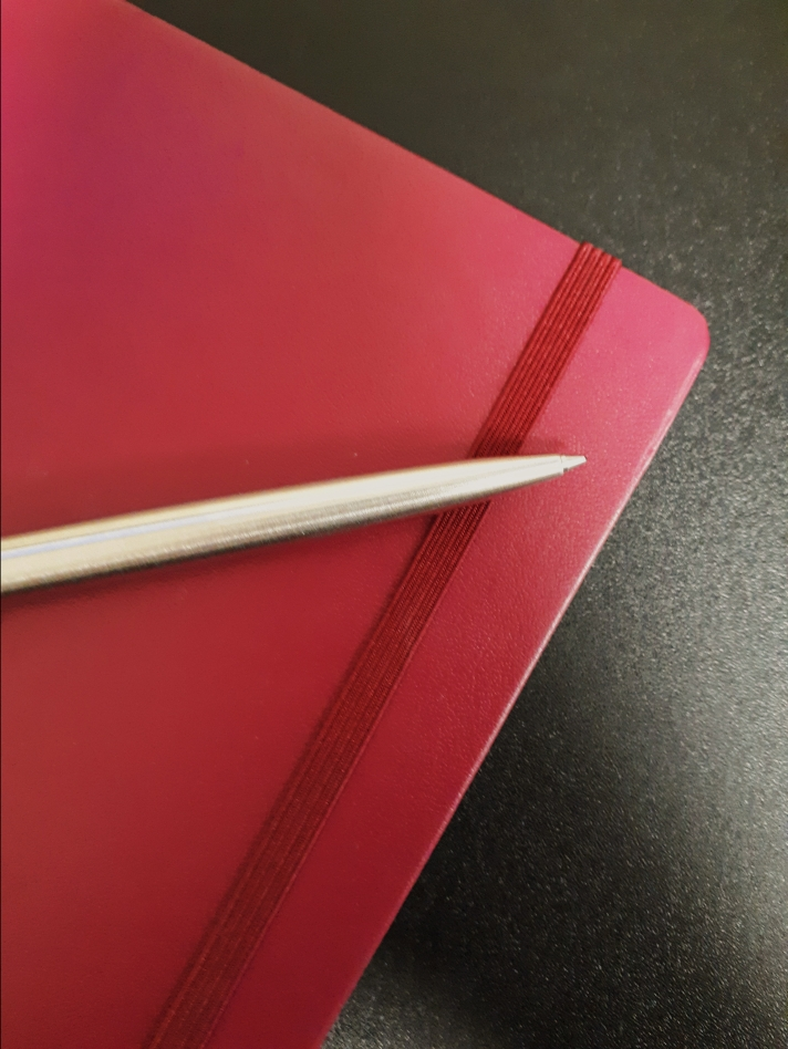 Leuchtturm1917 A5 in a dark red colour with a silver Parker Pen