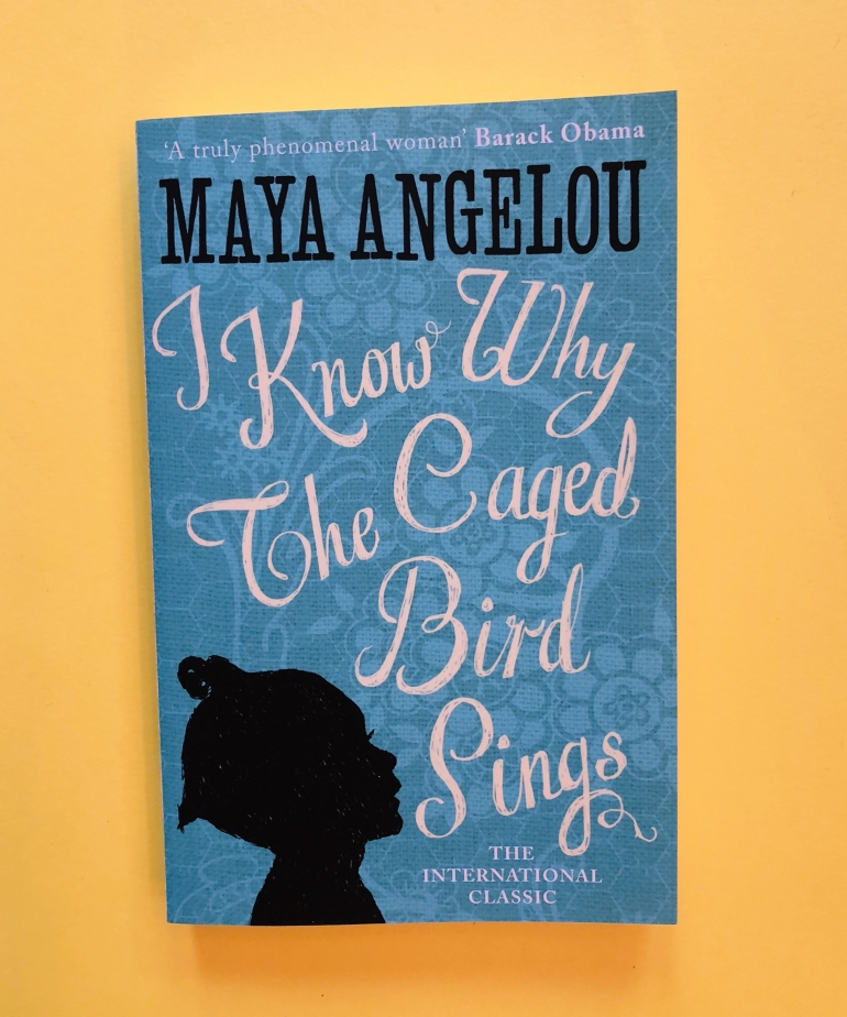 Blue cover of Angelou's novel against a yellow background - taken from