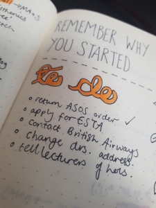 Photo from Rosie's bujo of a bright orange title saying 'to do', with note in black below