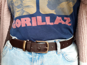 Blue Gorillaz tee tucked into pale blue mom jeans with a brown belt
