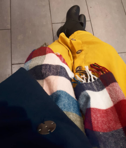 Bright yellow skirt, with checkered scarf