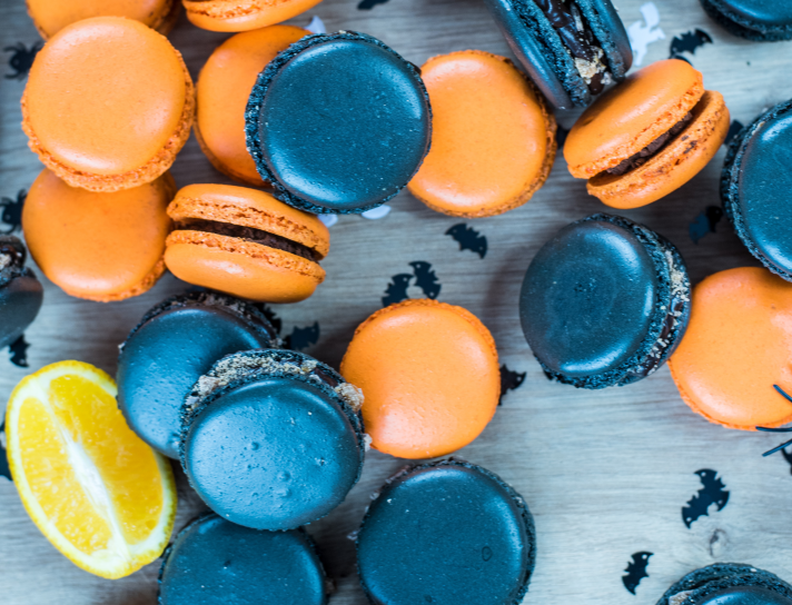 Black and orange macarons with bat confetti