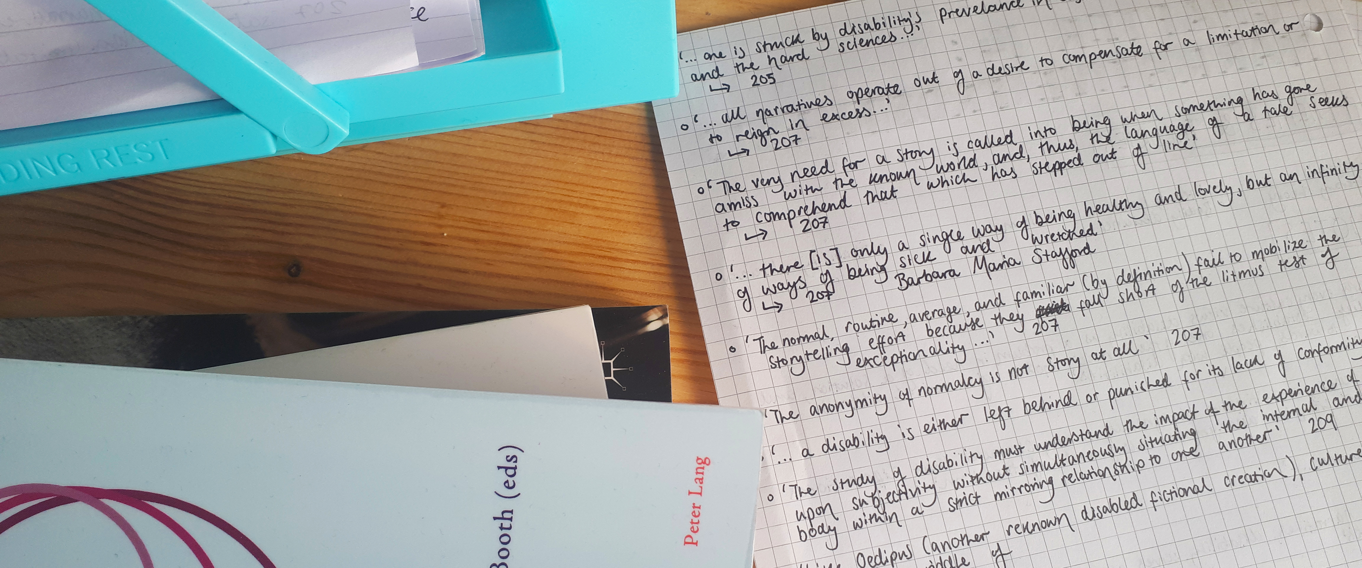 Close up of Rosie's study space, with books and notes