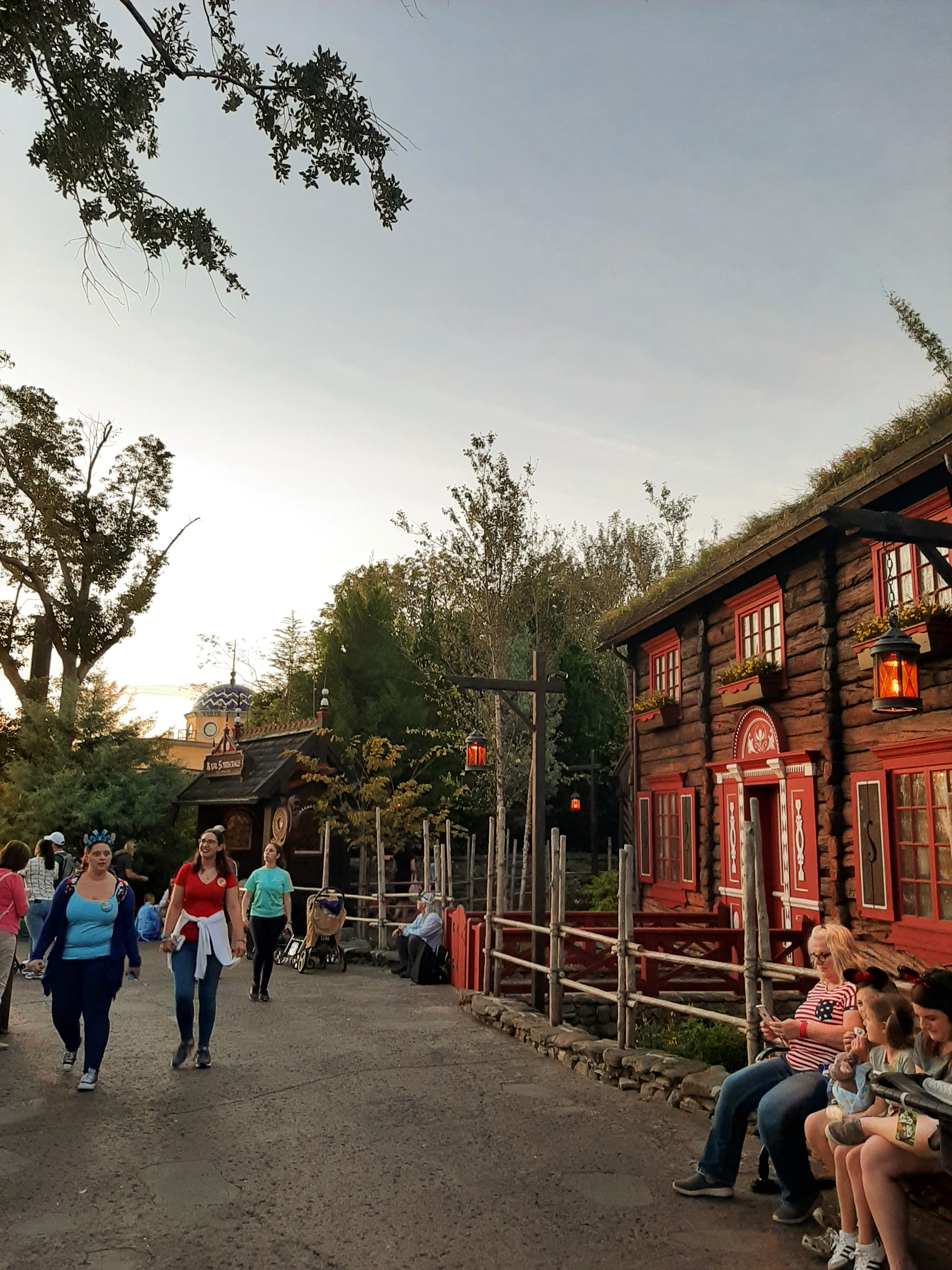 Brown log house and crowds in Norway at EPCOT's World Showcase