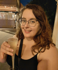 Rosie holding a glass of Fior D'Arancio Moscato