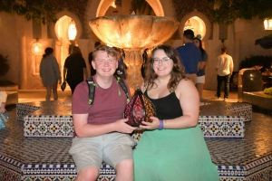 Rosie and her partner Rory holding a brightly coloured lamp in the EPCOT Morocco Pavilion