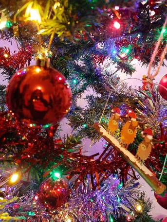 Christmas tree decorated with various baubles and multi-coloured lights