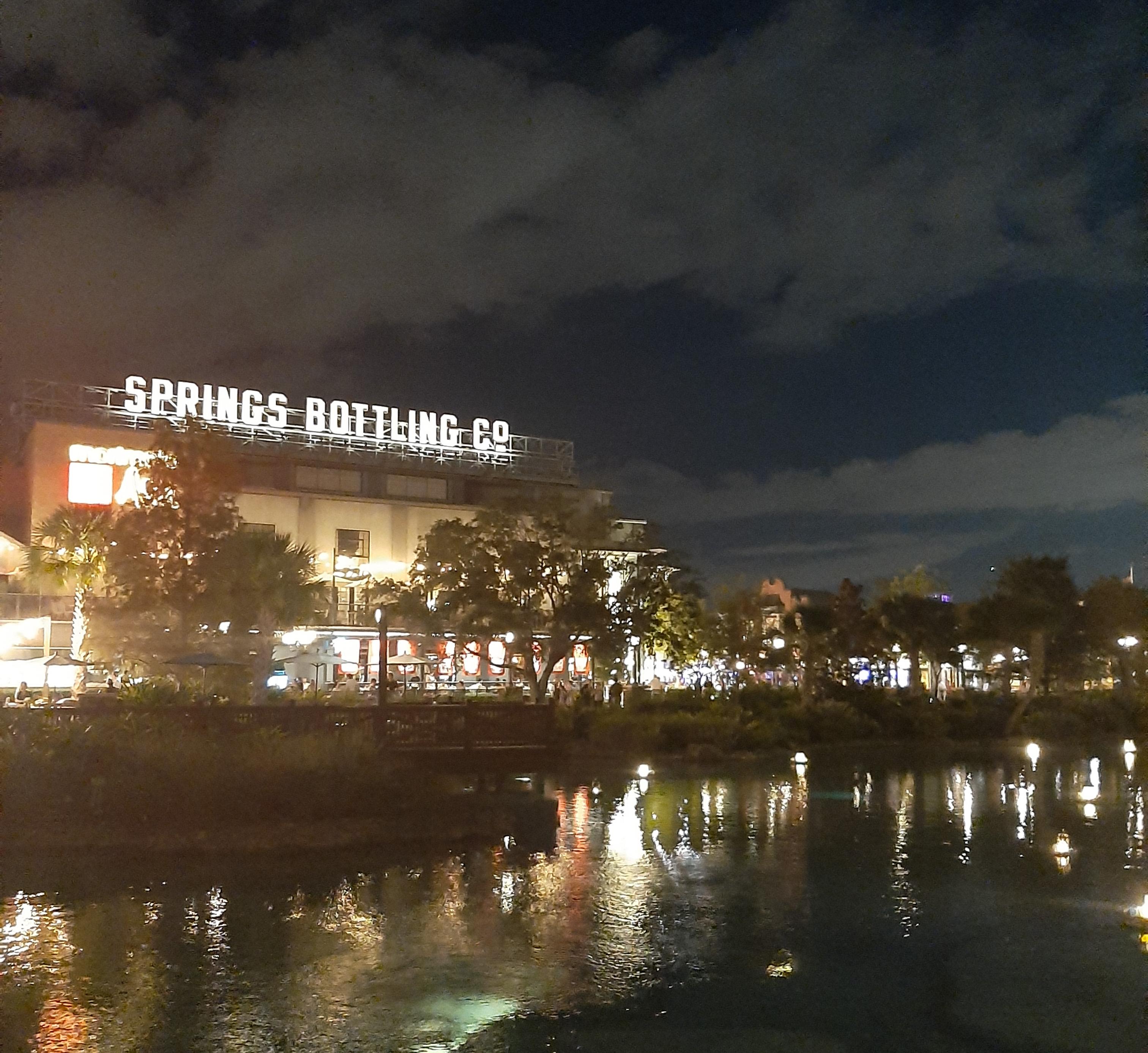 Springs Bottling Co against a dark dusk sky