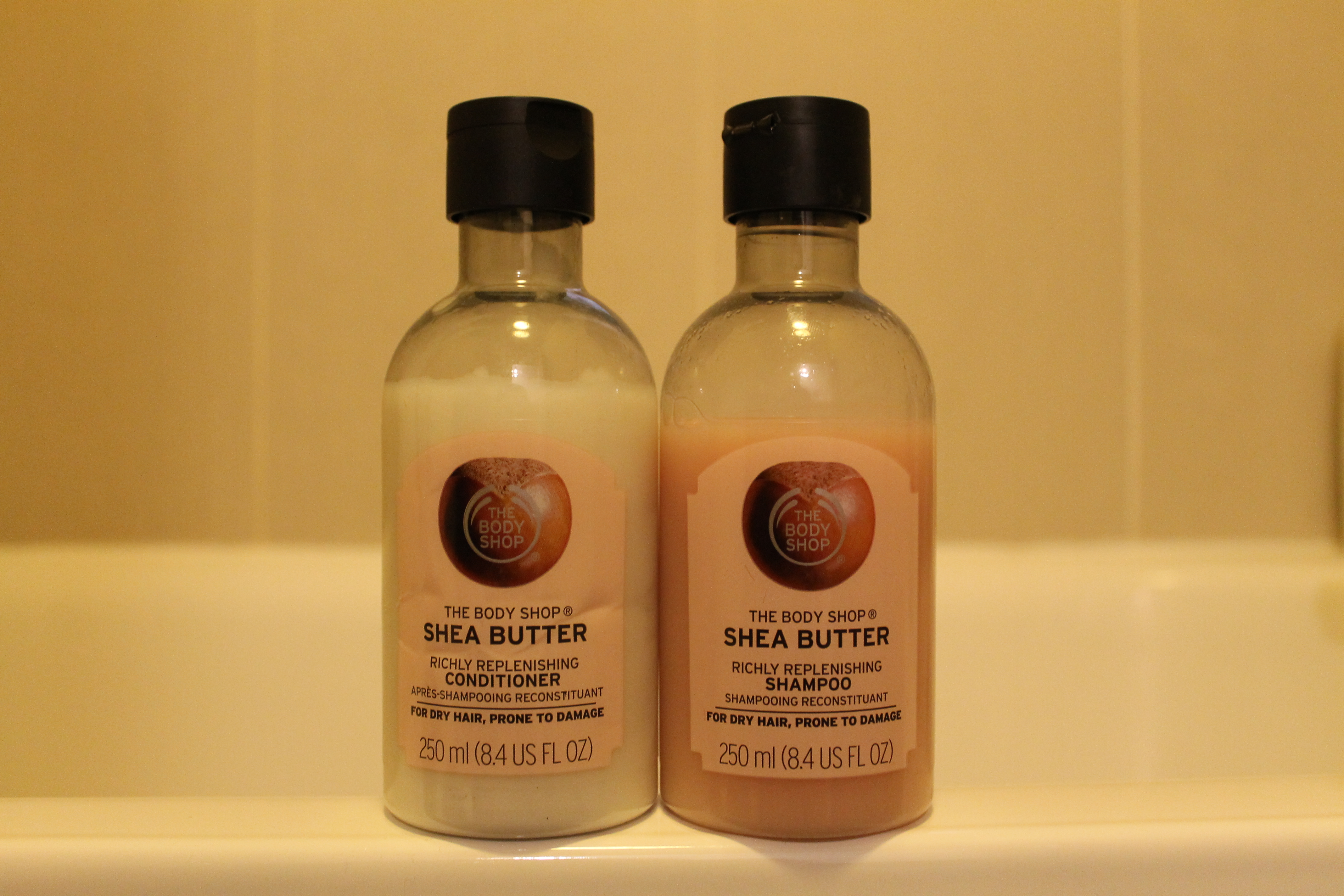 CLose up of two bottles in the The Body Shop Shea Butter Hair Care Range | rosie abigail