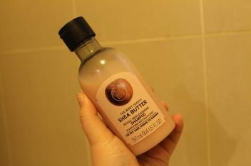 Close up of Shea Butter shampoo bottle