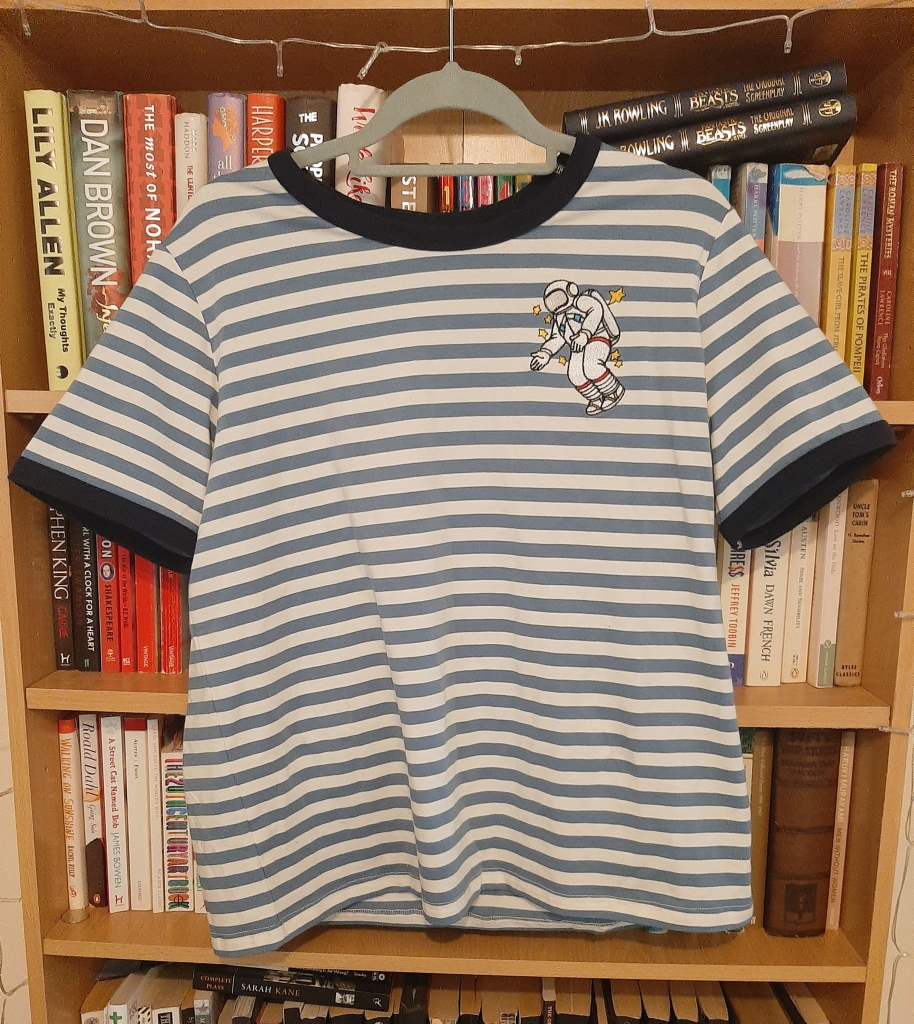 Blue and white striped tee with an embroidered astronaut