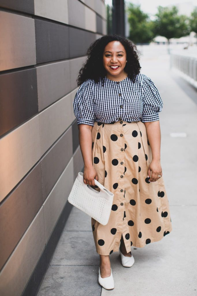 Nicole wearing a black and white gingham top, and a tan maxi skirt with black dots