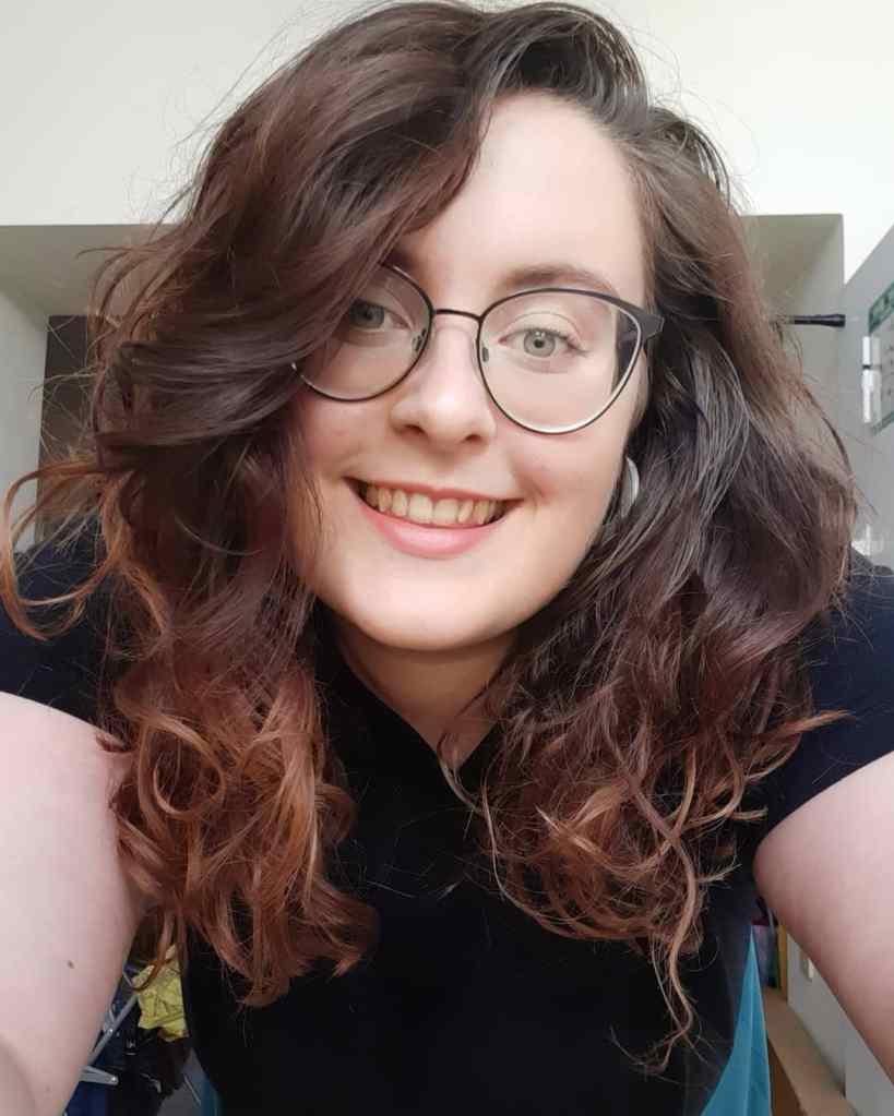 Selfie of Rosie with armpit length brown hair