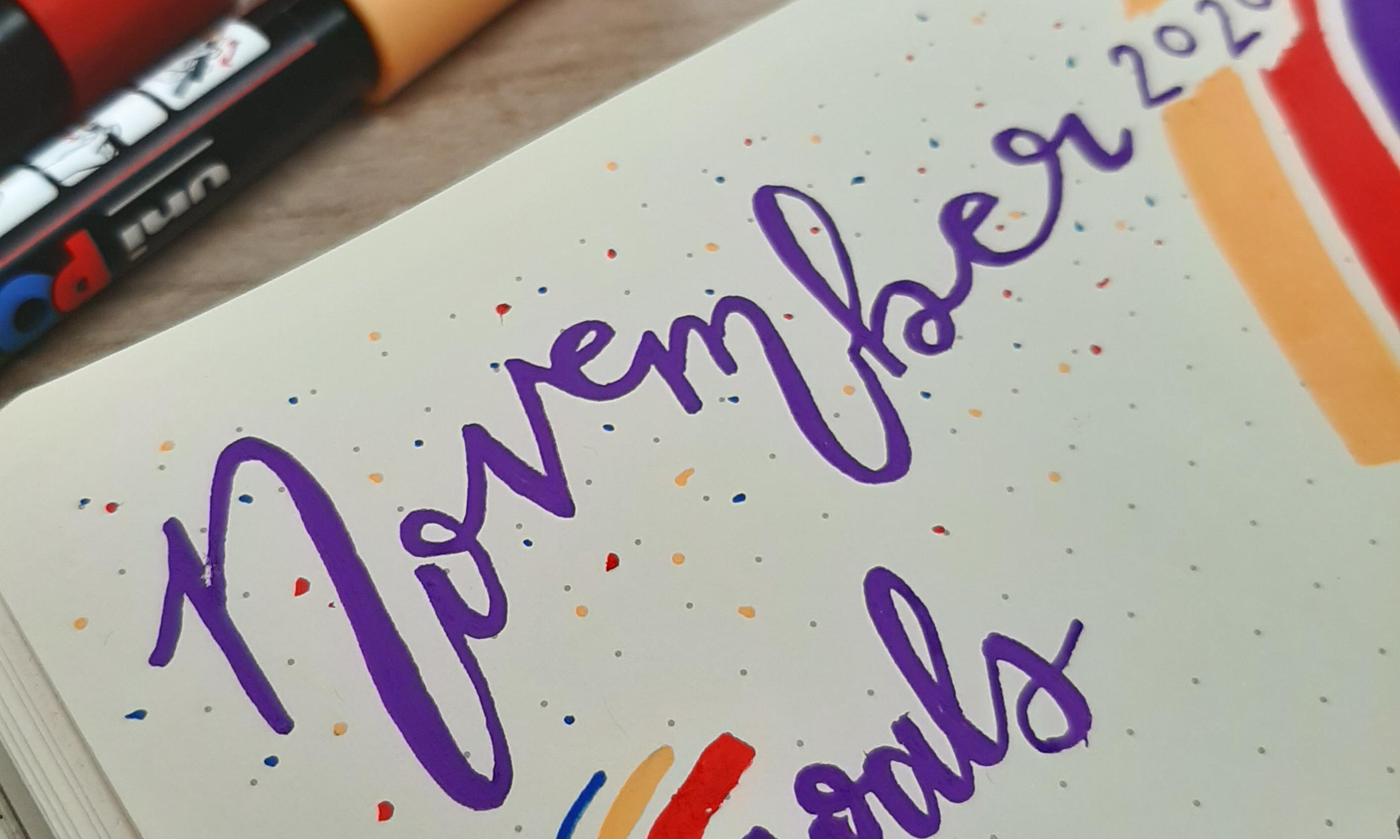 November written in purple calligraphy